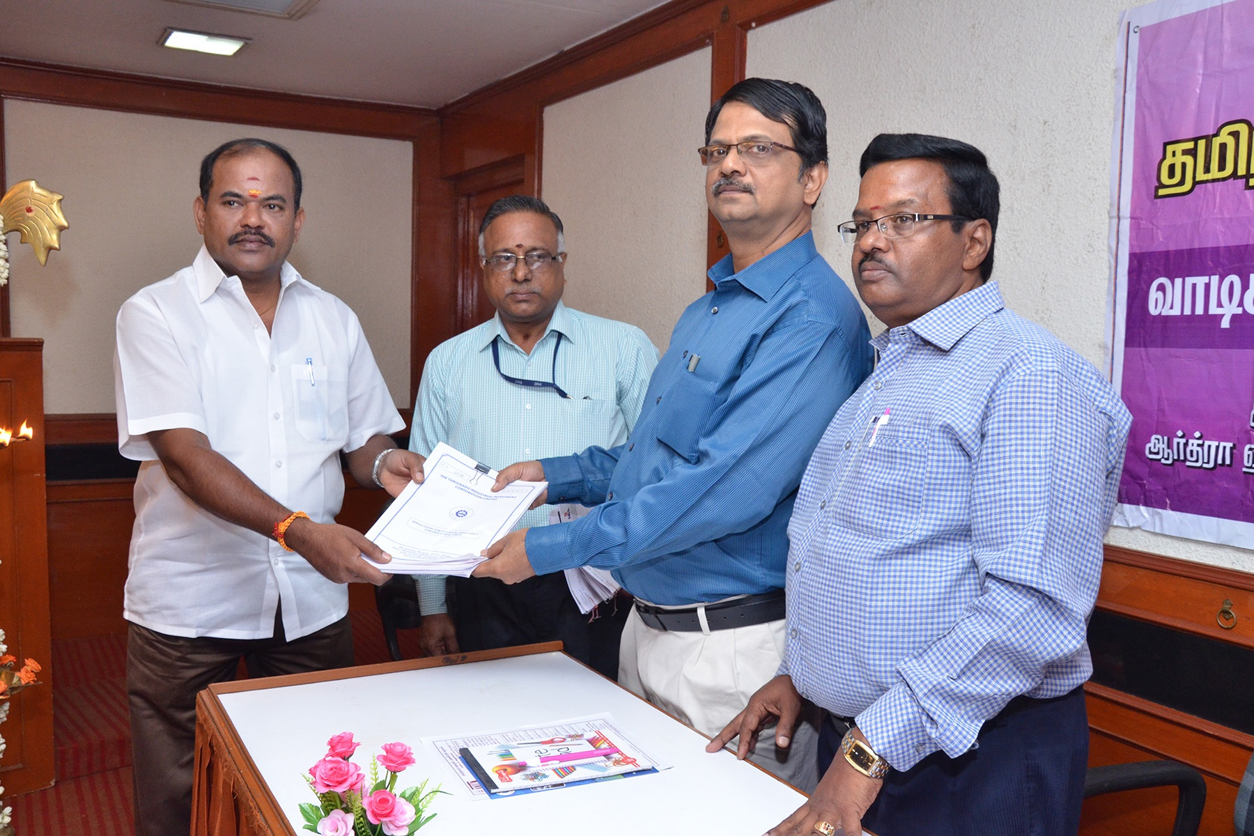 Mr.Kirubakaran R, GM-I, issuing application to a Customer during our Special Business Campaign at Erode Branch Office -